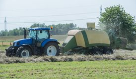 Baler at the haymaking. Process in s. h. in germany stock photography