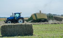 Baler at the haymaking. Process in s. h. in germany stock photos