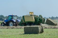 Baler at the haymaking. Process in s. h. in germany royalty free stock photo