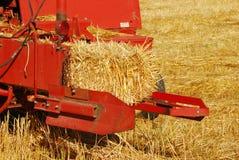 Baler. Old style hay baler in a wheat straw field in Umpqua Oregon stock photos