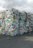 Bales of crushed plastic bottles for recycling Stock Photo
