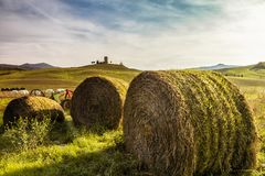 Bales of hay on a farm at sunset. In Tuscany Italy Stock Photo