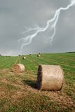 Bales of hay ont he hill Stock Images