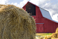 Bales of Hay by Red Barn Stock Photography