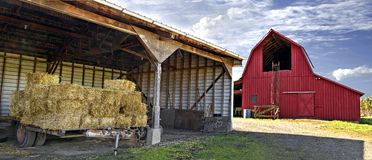 Bales of Hay by Red Barn Panorama Royalty Free Stock Images