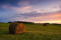 Bales of hay at sunset Royalty Free Stock Photography