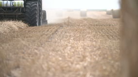 Bales of hay, tractor working in field stock video