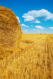 Bales of straw on harvested wheat field Stock Photo