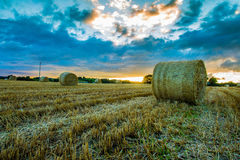 Bales of straw on Irish field at sunset. A field with baled hay or straw in Ireland at sunset royalty free stock photo