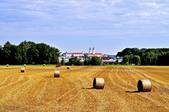 Bales of straw. Sight from Bavarian lands. Bales of straw were all wrapped up in the morning. Beautiful sight, Freising Royalty Free Stock Images