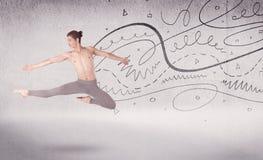 Balettdansörföreställningskonstdans med linjer och pilar Arkivbild