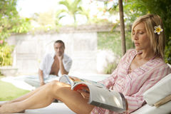 Bali 1 Couple Relaxing by Swimming Pool Stock Image