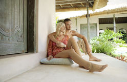 Bali 1 Couple Sitting on Floor in Garden Royalty Free Stock Photos