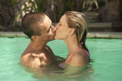 Bali 1 Kissing in Swimming Pool Royalty Free Stock Images