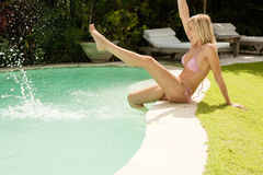 Bali 1 Woman Kicking Water in Pool Royalty Free Stock Images