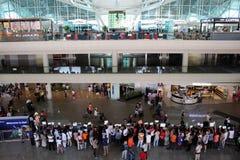 Bali airport arrivals hall. Denpasar, Indonesia - November 19, 2015: People waiting at the arrivals hall of Ngurah Rai International Airport (Denpasar) in Bali Stock Image