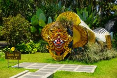 Bali barong from indonesia on the middle of garden park with green grass and background - indonesia stock photography