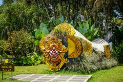 Bali barong from indonesia on the middle of garden park with green grass and background - indonesia stock photo