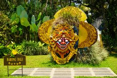 Bali barong from indonesia on the middle of garden park with green grass and background - indonesia royalty free stock photography