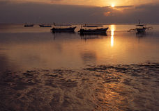 Bali Beach. Boat beach sand water sky sun down sun sea ocean cloud clouds horizontal bali nusa dua Royalty Free Stock Image