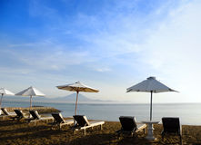 Bali beach resort scene with loungers