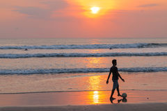 Bali beach. Sunset ocean surf Royalty Free Stock Images