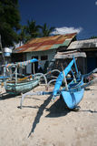 Bali boats and beach huts Royalty Free Stock Photography