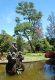 Bali Botanic Garden fountain. A photograph of the grounds of the botanic garden in Bali, with stone sculpture fountain in a pond. Located in the Bali Botanic royalty free stock photo