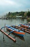 Bali Bratan lake and colorful boats Stock Photography