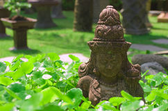 Bali culture. Figurine of Buddha in lotus leaves Stock Images