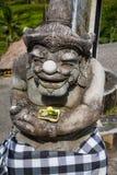 Bali deity of stone Stock Images
