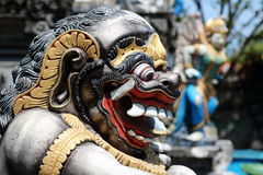 Bali Demon 2. Side view of the face of a Balinese monster guarding an entrance in Bali, Indonesia Royalty Free Stock Images