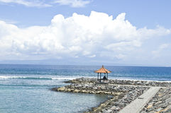 Bali dreamers. Beautiful indian ocean views near the pier. Indonesia. Blue cloudy sky Stock Photos