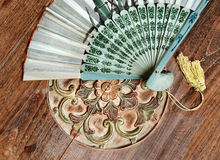 Bali fan on the orient table. Bali fan on the table in orient style stock photo