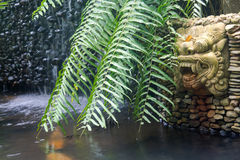 Bali garden with dragon statue and waterfall Royalty Free Stock Photography