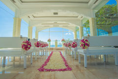 Bali glass church wedding. ,Rose petals covered the ground stock images