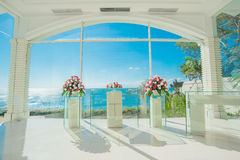 Bali glass church wedding. ,Rose petals covered the ground stock photography