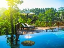 Bali, Indonésie - 14 avril 2014 : Vue de piscine à la station de vacances et à la station thermale de jungle de Nandini Photographie stock