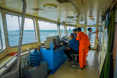 BALI, INDONESIA - APRIL 05, 2017: Ferry boat pilot command cabin with the captain operating the machines with a many Stock Photos