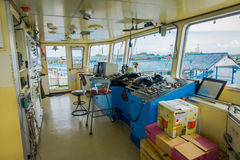 BALI, INDONESIA - APRIL 05, 2017: Ferry boat pilot command cabin with view on the sea Royalty Free Stock Photo