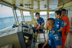 BALI, INDONESIA - APRIL 05, 2017: Ferry boat pilot command cabin with view on the sea with many assistants there in Ubud stock image