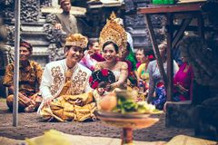 BALI, INDONESIA - APRIL 13, 2018: People on balinese wedding ceremony. Traditional wedding. royalty free stock photo