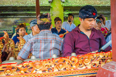 BALI, INDONESIA - APRIL 05, 2017:Unidentified people playing some musical instruments inside of a building in the. Beautiful temple in Ubud Bali located in Royalty Free Stock Image