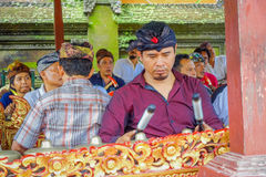 BALI, INDONESIA - APRIL 05, 2017:Unidentified people playing some musical instruments inside of a building in the. Beautiful temple in Ubud Bali located in Royalty Free Stock Photography