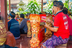 BALI, INDONESIA - APRIL 05, 2017:Unidentified people playing some musical instruments inside of a building in the. Beautiful temple in Ubud Bali located in Royalty Free Stock Images