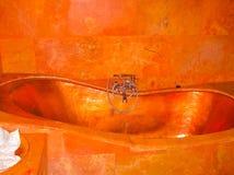 Bali, Indonesia - April 11, 2012: View of copper bathroom at Tanah Merah Art Resort Stock Images