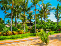 Bali, Indonesia - April 14, 2014: View of cottages at the beach in St. Regis Resort Royalty Free Stock Photos