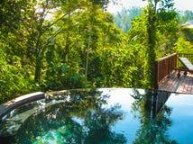 Bali, Indonesia - April 14, 2014: View of swimming pool at Nandini Jungle Resort and Spa. Stock Photos