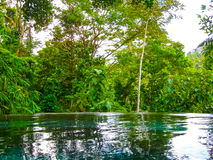 Bali, Indonesia - April 13, 2014: View of swimming pool at Nandini Jungle Resort and Spa. Royalty Free Stock Photography