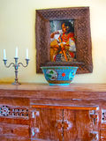 Bali, Indonesia - April 11, 2012: View of wooden furniture, painting, a work of art at Tanah Merah Art Resort Stock Photo